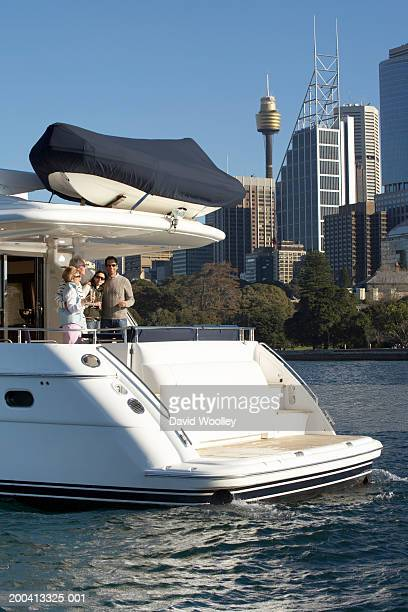 Senior and mature couple having drinks on yacht, view across water