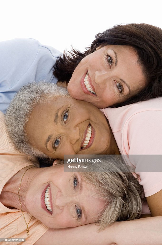 Senior and mature women resting heads together, smiling, portrait : Stock Photo