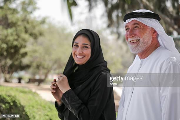 Senior arab man and young woman