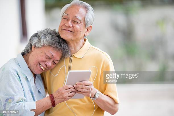 Senior Asian Couple Listening to Music