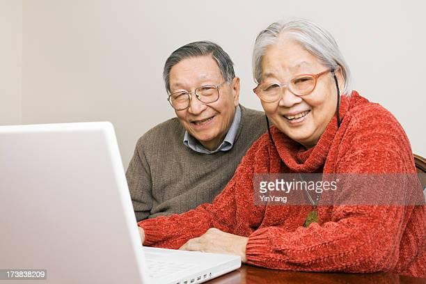 Senior Asian Couple Using Laptop Computer, Elder Chinese People Communicating