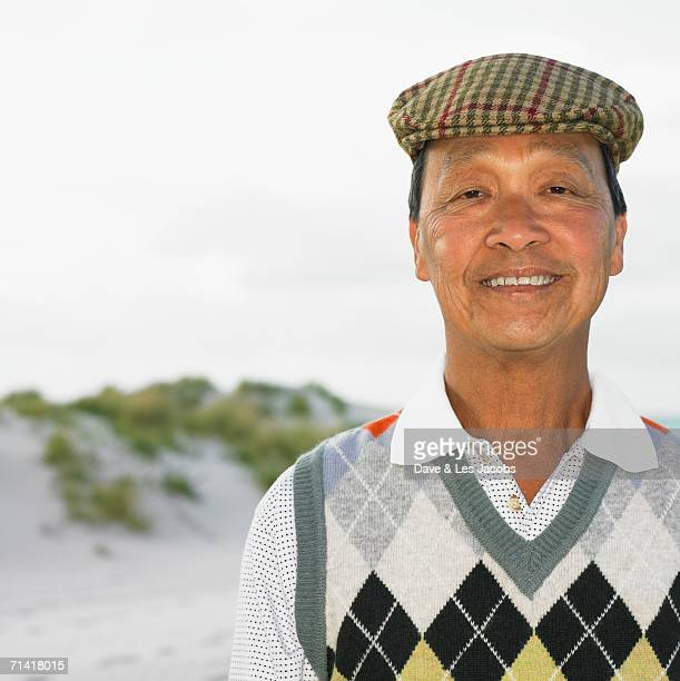 Senior Asian man at the beach