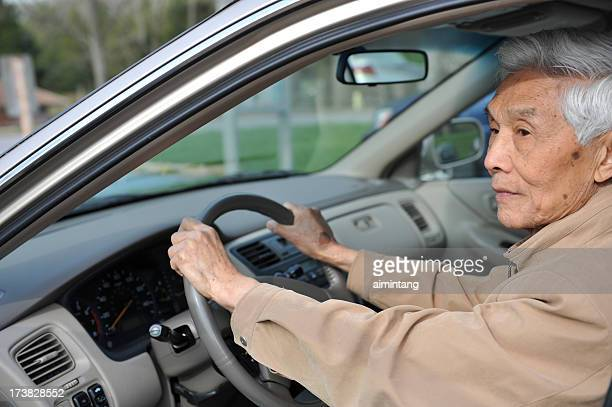 Senior Asian Man behind Wheel in Car