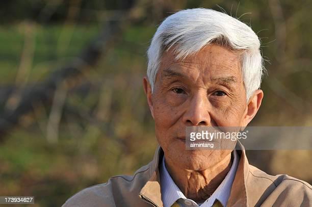 Senior Asian Man Looking Straight