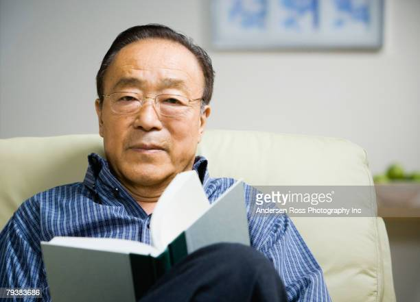 Senior Asian man reading book