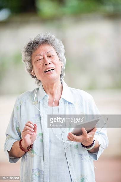 Senior Asian woman Listening to Music