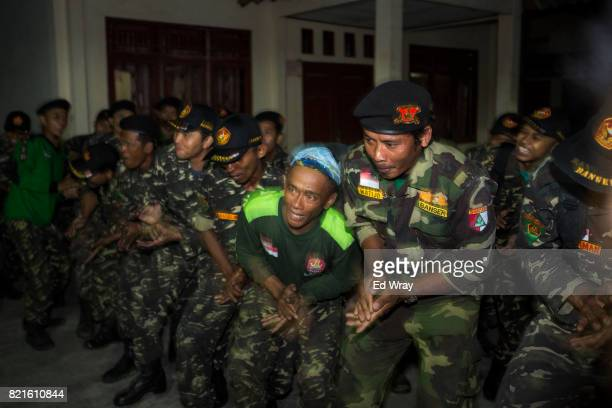 Senior Banser instructors dance to keep their energy up during a rigorous three day induction course on July 22 2017 in Kebumen Indonesia Banser the...