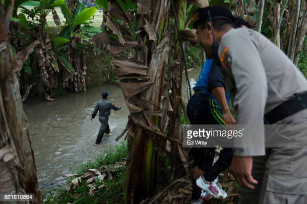 Senior Banser members prepare an obstacle course for recruits during a three day induction course on July 21 2017 in Kebumen Indonesia Banser the...