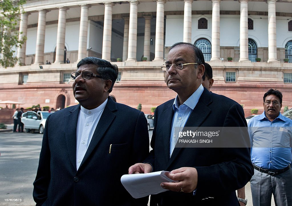 Senior Bhartiya Janata Party (BJP) leaders Arun Jaitley (R) and Ravi Shankar Prasad prepare to address the media at Parliament house during the winter session in New Delhi on December 5, 2012. India's government, which lost its majority in September, faced a test of its ability to marshal support in parliament on Wednesday with a vote on a contentious recent reform of the retail sector. After two days of stormy debating in the rowdy lower house, lawmakers are set to pass judgement on new rules opening up the highly protected retail sector to foreign supermarkets that are being allowed in for the first time. AFP PHOTO/ Prakash SINGH