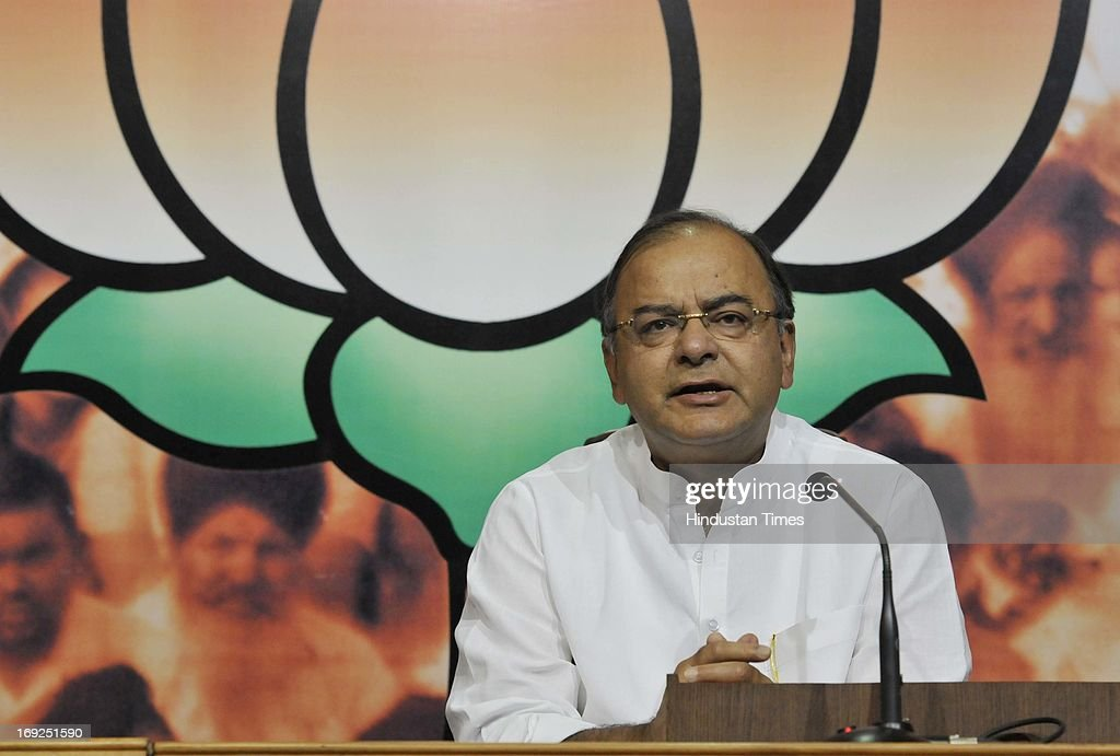 Senior BJP leader Arun Jaitley briefs media personnel at a press conference at the party office on May 22, 2013 in New Delhi, India. Attacking the UPA-II government on its fourth anniversary, they said that government has failed to provide leadership, keep its coalition together, improve the economy, check corruption, or ensure national security and safety of women.