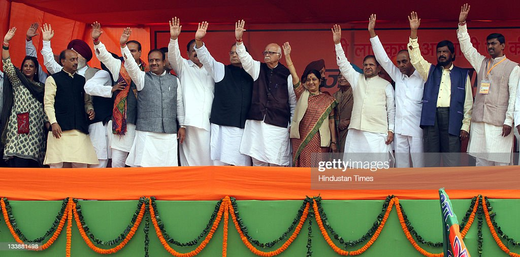 Senior BJP leader L K Advani along with other senior leader of NDA wave during last public meeting of his ' Jan Chetna Yatra' at Ramlila maidan in...