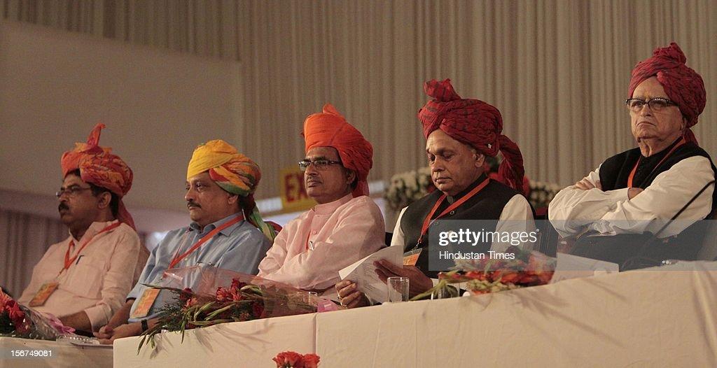 'SURAJKUND, INDIA - SEPTEMBER 27: (R-L) Senior BJP leader L K Advani, Himachal CM Prem Kumar Dhumal, Madhya Pradesh CM Shivraj Singh Chauhan and Goa CM Manohar Parrikar at the party's National Council meeting at Surajkund on September 27, 2012 in Faridabad, India. (Photo by Sunil Saxena/Hindustan Times via Getty Images)'