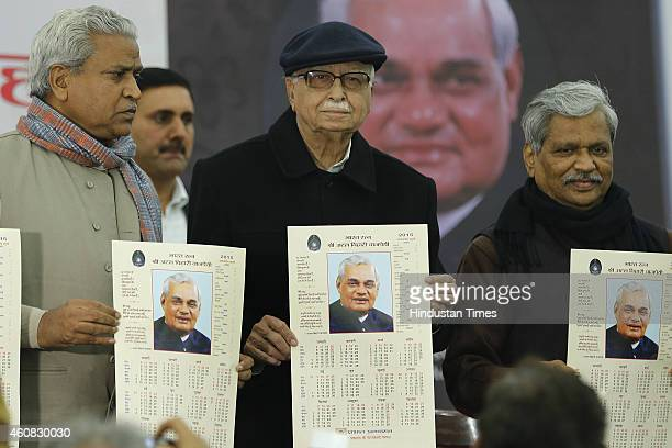 Senior BJP leader Lal Krishna Advani along with Ram Lal and BJP Leader Prabhat Jha holding calendars carrying the former PM Atal Bihari Vajpayee's...