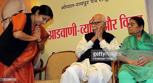 Senior BJP leader LK Advani along with his wife Kamla Advani and Sushma Swaraj during a function for the launch of a special edition of Swadesh group...