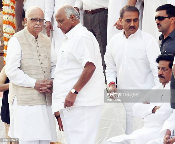 Senior BJP leader LK Advani and NCP Chief Sharad Pawar at the funeral of Shiv Sena Chief Balasaheb Thackeray in Mumbai on November 18 2012