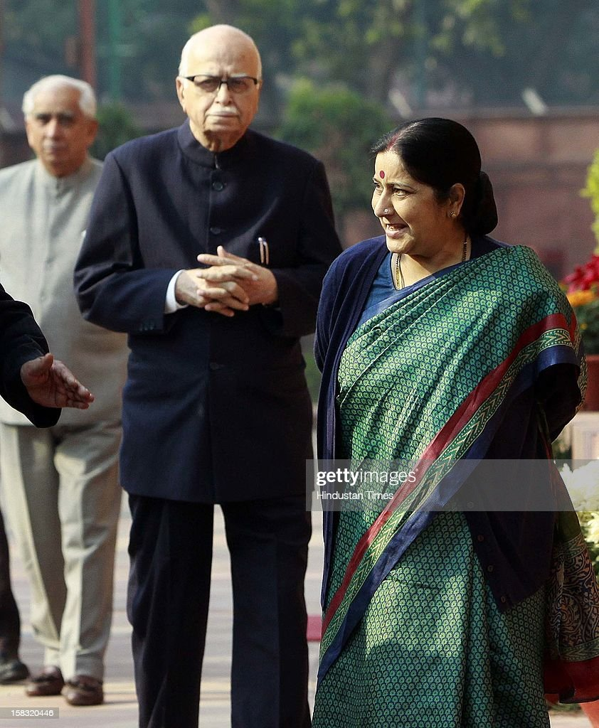 Senior BJP leader LK Advani and Sushma Swaraj before paying tributes to the martyrs of 2001 Parliament attack on its 11th anniversary, at Parliament House on December 13, 2012 in New Delhi, India.