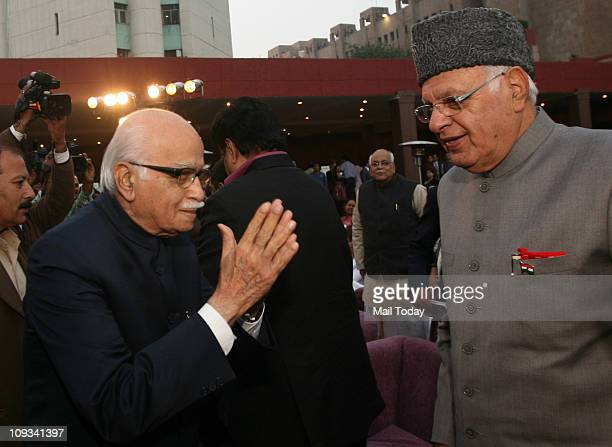 Senior BJP Leader LK Advani greeting Union Minister Dr Farooq Abdullah during the launch of the book 'Impressions' written by BJP leader Najma...