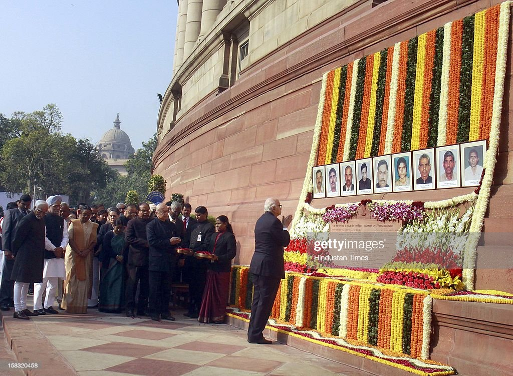 Senior BJP leader LK Advani pays homage to martyrs during a remembrance ceremony of the 2001 Parliament attack, at Parliament House on December 13, 2012 in New Delhi, India. Politicans gathered to observe the eleventh anniversary of a bloody militant attack on the complex, which left 14 dead on December 13, 2001.
