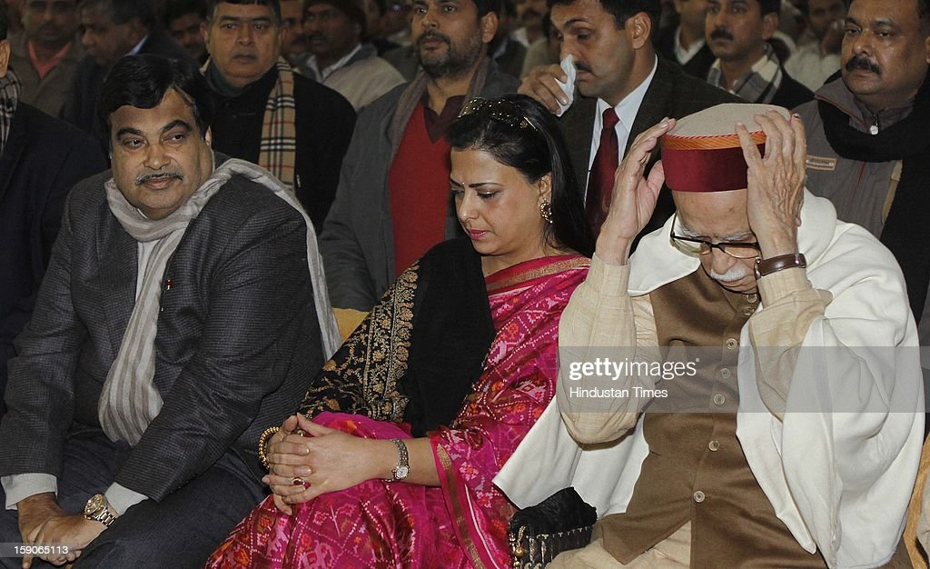 Senior BJP leader LK Advani with his daughter Pratibha Advani and BJP party president Nitin Gadkari at the function to mark the completion of the 1st phase of Ganga Samagra Abhiyan by Uma Bharati on January 7, 2013 in New Delhi, India.