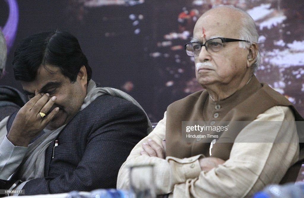 Senior BJP leader LK Advani with party president Nitin Gadkari at the function to mark the completion of the 1st phase of Ganga Samagra Abhiyan by Uma Bharati on January 7, 2013 in New Delhi, India.