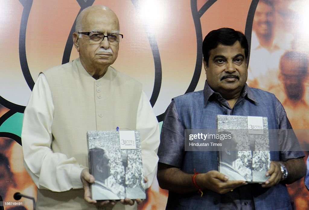 'NEW DELHI, INDIA- OCTOBER 20: Senior BJP leader LK Advani with party President Nitin Gadkari releases ''Atal Dairy 2013'' during a talk on ''Globalisation and Indian Society'' organized by Swami Vivekananda Study Circle at Ashoka Road on October 20, 2012 in New Delhi, India. ( Photo By Sonu Mehta/Hindustan Times via Getty Images)'