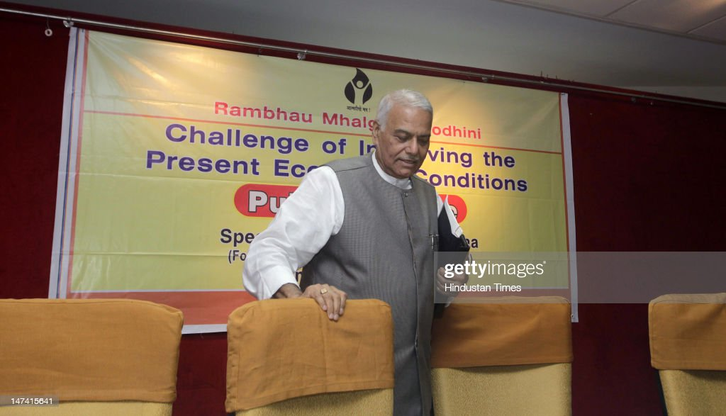 Senior BJP Leader <a gi-track='captionPersonalityLinkClicked' href=/galleries/search?phrase=Yashwant+Sinha&family=editorial&specificpeople=227891 ng-click='$event.stopPropagation()'>Yashwant Sinha</a> attends the lecture on the topic 'Challenge of Improving Present Economic Conditions' at the Maharashtra Chambers of Commerce, Industry and Agriculture June 29, 2012 in Mumbai, India. Sinha, who heads the Parliamentary Standing Committee on Finance said that FDI should not be treated as a cure for all problems and that BJP will oppose raising of foreign direct investment cap from 26 per cent to 49 per cent in insurance and pension sectors.
