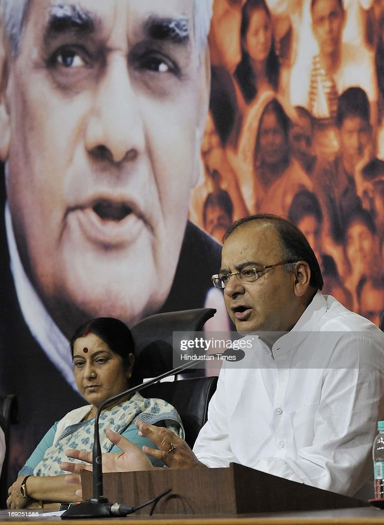 Senior BJP leaders Sushma Swaraj (L) and Arun Jaitley brief media personnel at a press conference at the party office on May 22, 2013 in New Delhi, India. Attacking the UPA-II government on its fourth anniversary, they said that government has failed to provide leadership, keep its coalition together, improve the economy, check corruption, or ensure national security and safety of women.