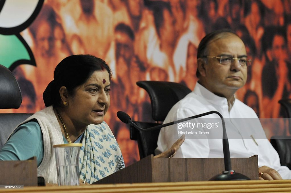 Senior BJP leaders Sushma Swaraj (L) and Arun Jaitley (R) brief media personnel at a press conference at the party office on May 22, 2013 in New Delhi, India. Attacking the UPA-II government on its fourth anniversary, they said that government has failed to provide leadership, keep its coalition together, improve the economy, check corruption, or ensure national security and safety of women.