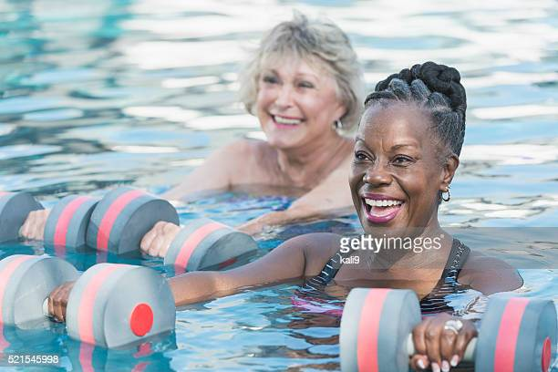 Senior black woman and friend doing water aerobics