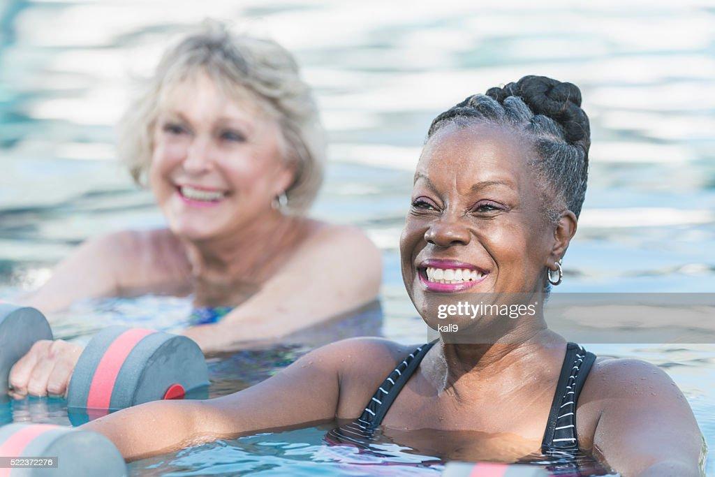 Senior black woman and friend doing water aerobics : Stock Photo