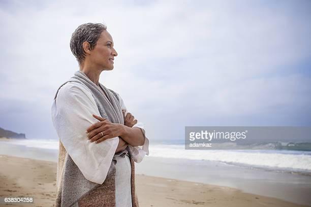 Senior Black Woman Relaxing on Beach