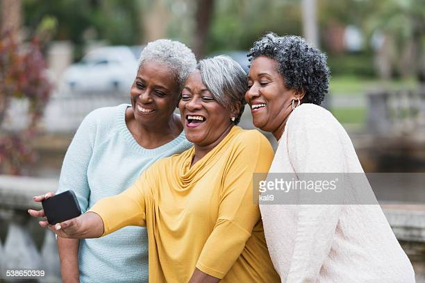 Senior black women taking a selfie