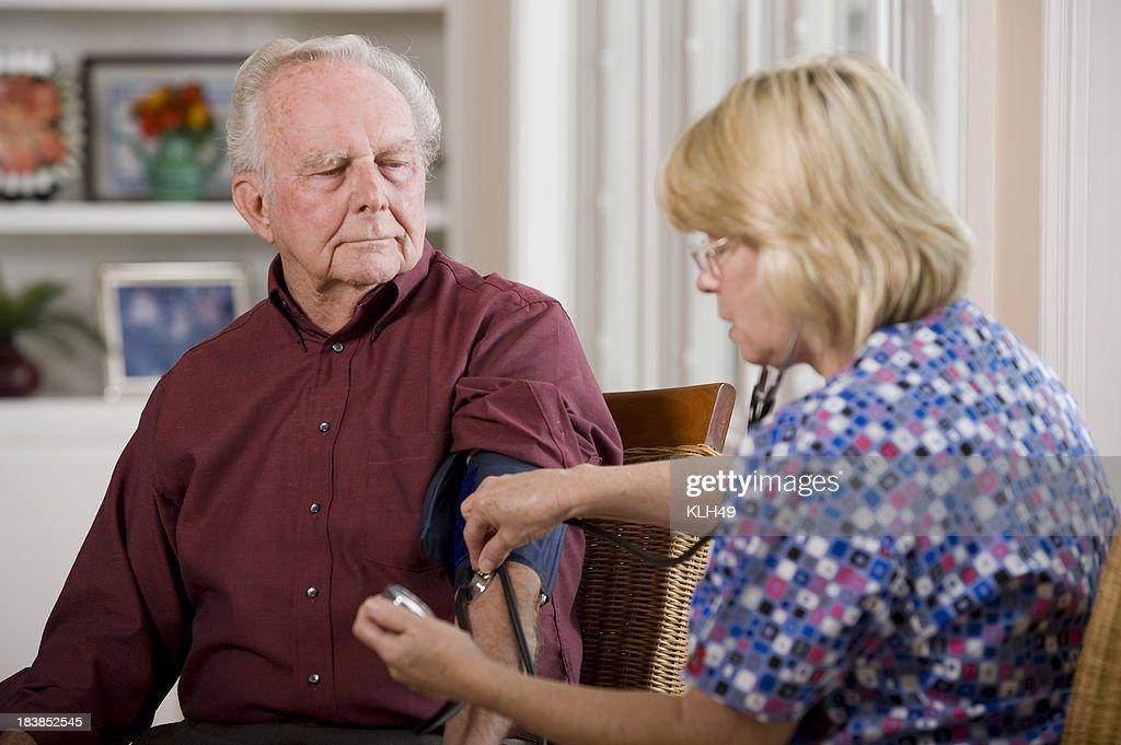 Senior Blood Pressure check : Stock Photo