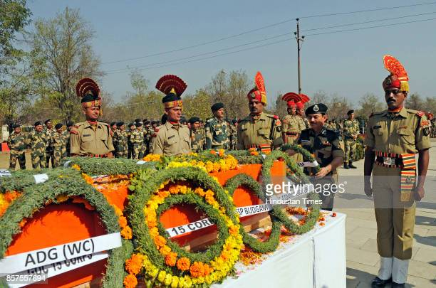 Senior Border Security Force official lays a wreath on the coffin of Brij Kishore Yadav a 50yearold assistant subinspector during a wreathlaying...