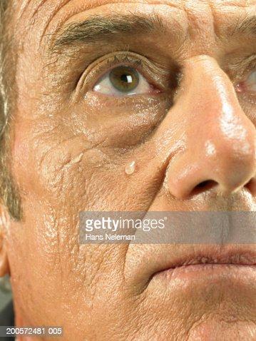 Senior business man crying, close-up, portrait