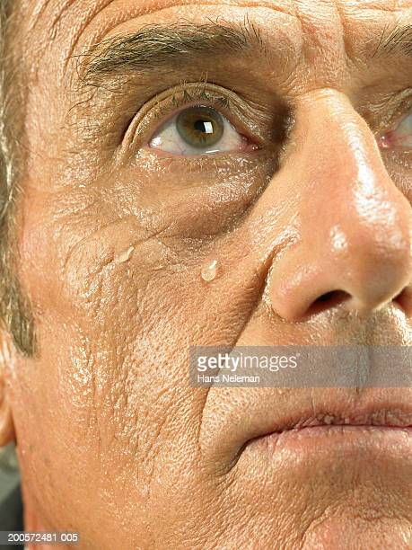 Senior business man crying, close-up, portrait