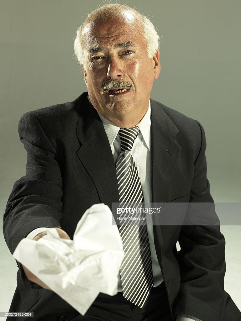 Senior business man holding tissue, crying, portrait : Stock Photo