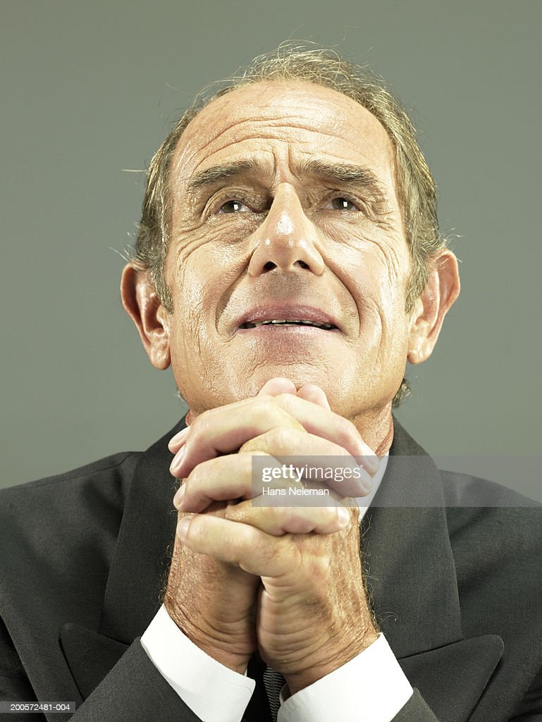 Senior business man with hands clasped, portrait : Stock Photo