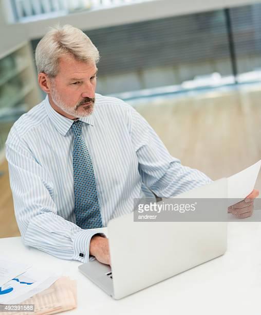 Senior business man working online