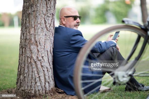 Senior Businessman At Public Park