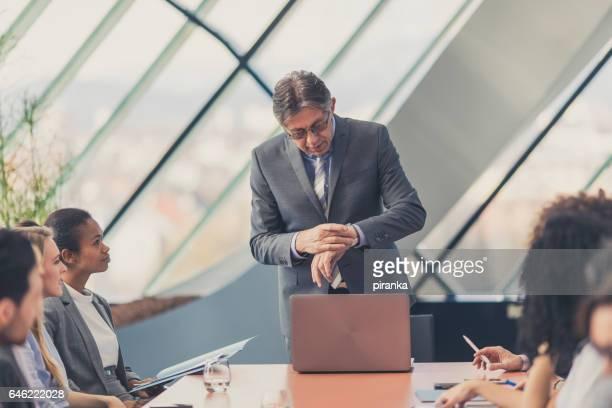 Senior businessman having a business presentation
