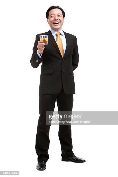 Senior businessman holding a glass of whiskey