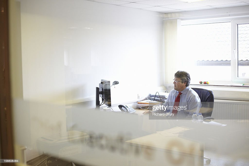 Senior businessman in office : Stock Photo