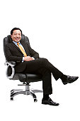 Senior businessman sitting on director's chair
