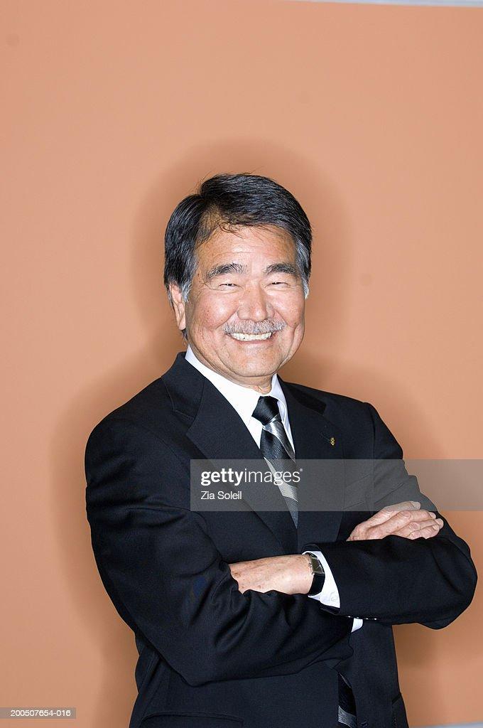 Senior businessman smiling, portrait : Stock Photo
