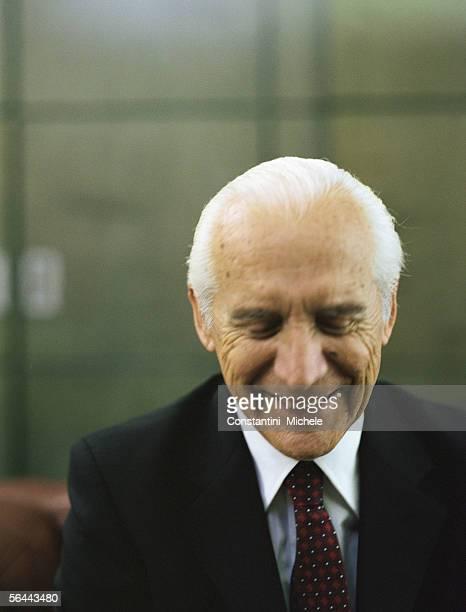 Senior businessman smiling with eyes closed, portrait