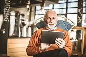 Senior businessman using technology.