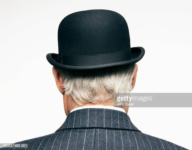 Senior businessman wearing bowler hat, close-up, rear view