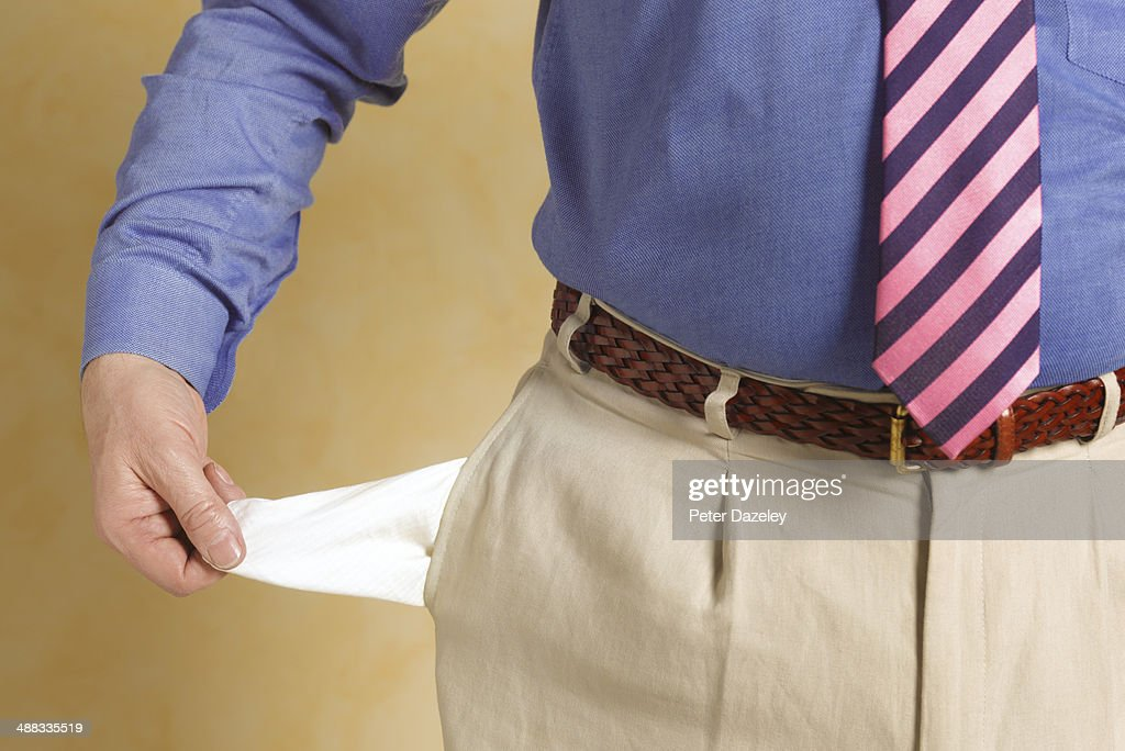 Senior businessman with empty pocket