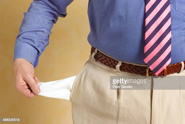 Senior businessman with empty pocket